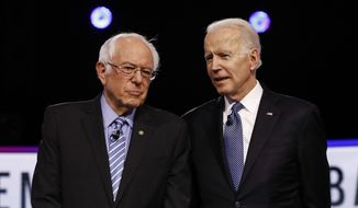 In this Tuesday, Feb. 25, 2020 file photo, Democratic presidential candidates, Sen. Bernie Sanders, I-Vt., left, and former Vice President Joe Biden, talk before a Democratic presidential primary debate in Charleston, S.C. (AP Photo/Matt Rourke)
