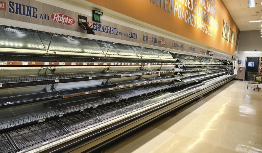 An entire section of meat and poultry is left empty after panicked shoppers swept through in fear of the coronavirus at a local grocery store in Burbank, Calif., on Saturday, March 14, 2020. (AP Photo/Richard Vogel) ** FILE **