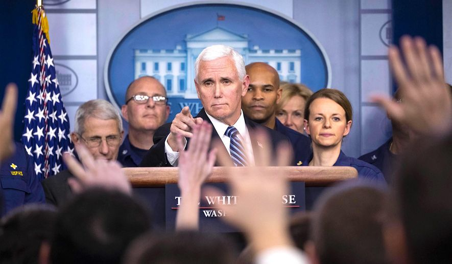 Vice President Mike Pence directs a press briefing about the coronavirus; his increasing public profile is winning him some fans. (Associated Press)