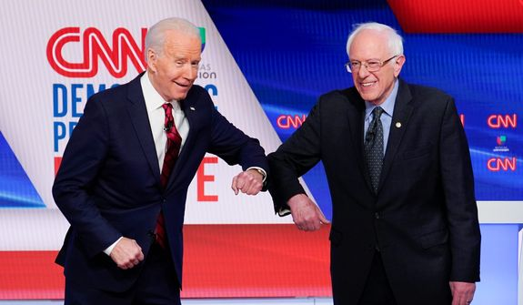 Former Vice President Joseph R. Biden (left), and Sen. Bernard Sanders squabbled like schoolchildren at Sunday's Democratic debate. (Associated Press)