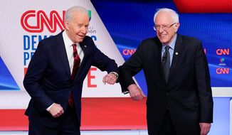 Former Vice President Joseph R. Biden (left), and Sen. Bernard Sanders squabbled like schoolchildren at Sunday's Democratic debate. (Associated Press)