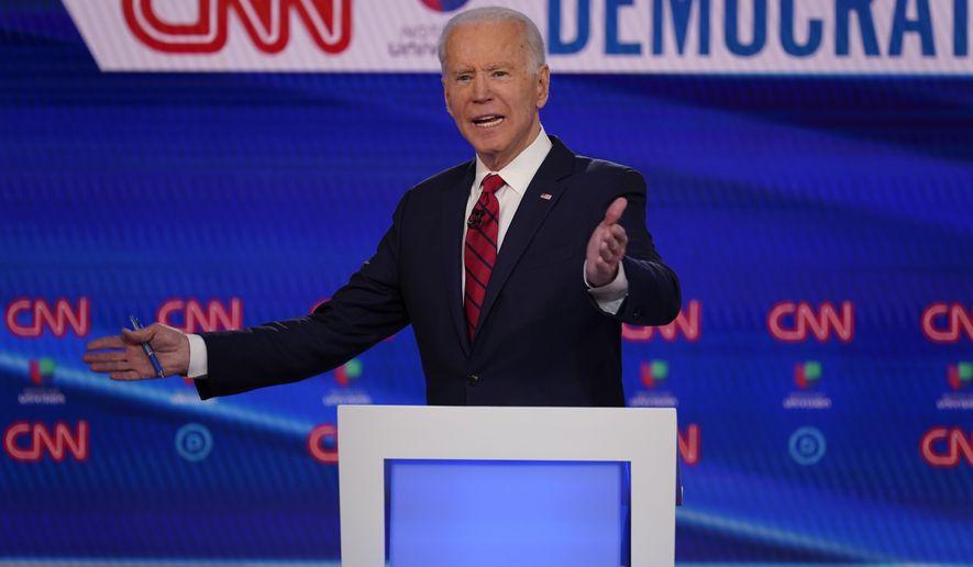 Sen. Bernie Sanders, I-Vt., and former Vice President Joe Biden, participate in a Democratic presidential primary debate at CNN Studios, Sunday, March 15, 2020, in Washington. (AP Photo/Evan Vucci)