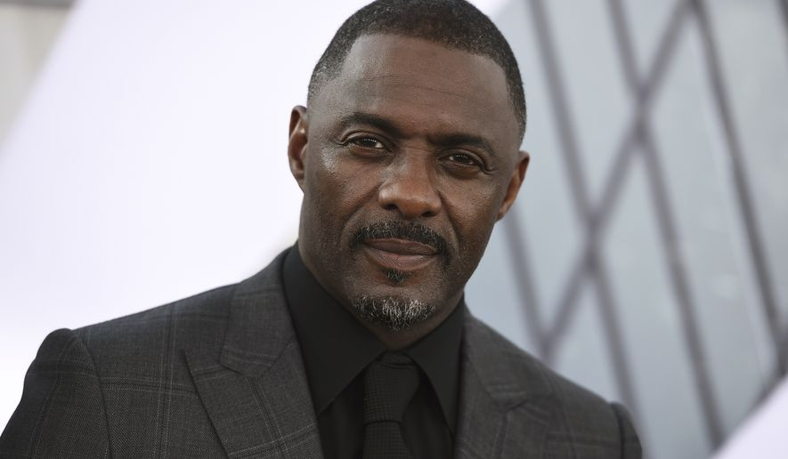 """In this July 13, 2019, file photo, Idris Elba arrives at the Los Angeles premiere of """"Fast & Furious Presents: Hobbs & Shaw."""" (Photo by Jordan Strauss/Invision/AP, File)"""