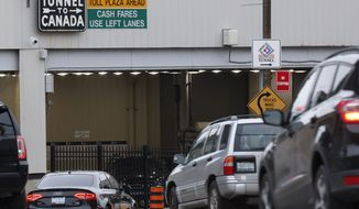 Vehicles enter the Detroit-Windsor Tunnel to travel to Canada in Detroit, Monday, March 16, 2020. Canadian Prime Minister Justin Trudeau says he is closing his country's borders to anyone not a citizen, an American or a permanent resident amid the coronavirus outbreak. (AP Photo/Paul Sancya)