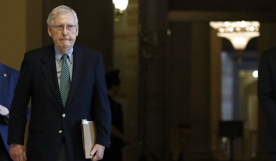 Senate Majority Leader Mitch McConnell of Ky. walks to the Senate Chamber on Capitol Hill in Washington, Monday, March 16, 2020. (AP Photo/Patrick Semansky)