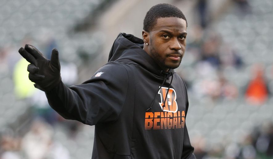 FILE - In this Dec. 1, 2019, file photo, Cincinnati Bengals wide receiver A.J. Green practices before an NFL football game against the New York Jets in Cincinnati. The Bengals used their franchise tag on A.J. Green, giving them time to try to work out a long-term deal with the star who is one of the most accomplished receivers in franchise history and would be a vital part of breaking in a new quarterback.(AP Photo/Frank Victores, File)