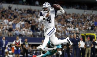 In this Sept. 22, 2019, file photo, Dallas Cowboys quarterback Dak Prescott (4) gets past Miami Dolphins defensive back Walt Aikens (35) and into the end zone for a touchdown in the second half of an NFL football game in Arlington, Texas. (AP Photo/Ron Jenkins, File)