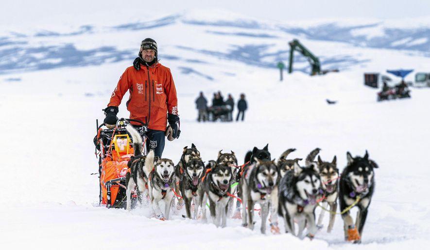 Thomas Waerner mushes into Unalakleet, Alaska, Sunday, March 15, 2020 during the Iditarod Trail Sled Dog Race. (Loren Holmes/Anchorage Daily News via AP) ** FILE **
