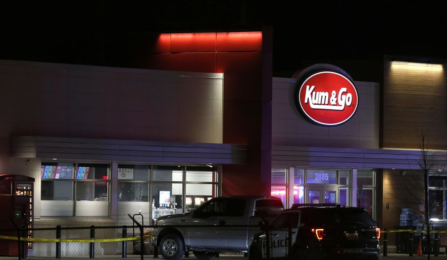 Police respond to the scene of a shooting at a gas station in Springfield, Mo, on Sunday, March 15, 2020. Police Chief Paul Williams said Monday morning, a Springfield police officer, three citizens and the gunman were killed. (Nathan Papes/The Springfield News-Leader via AP)