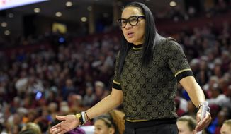FILE - In this March 8, 2020, file photo, South Carolina head coach Dawn Staley reacts during a championship match against Mississippi State at the Southeastern Conference women's NCAA college basketball tournament in Greenville, S.C. Staley knows that Monday, March 16, 2020, was supposed to be the night that women's basketball got put in the national spotlight with the NCAA Tournament bracket reveal. But with the NCAA Tournament canceled because of the coronavirus outbreak, she said she'll most likely be sitting at home with her dog, Champ. (AP Photo/Richard Shiro, File)