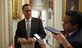 Sen. Mitt Romney, R-Utah, speaks with members of the media as he departs a meeting with Treasury Secretary Steve Mnuchin on an economic lifeline for Americans affected by the coronavirus outbreak on Capitol Hill in Washington, Monday, March 16, 2020. (AP Photo/Patrick Semansky) ** FILE **