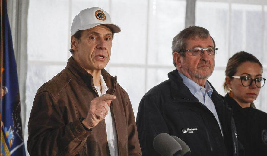In this Friday, March 13, 2020, photo, New York Gov. Andrew Cuomo (left) speaks during a news conference at a COVID-19 coronavirus infection testing facility at Glen Island Park in New Rochelle, N.Y. (AP Photo/John Minchillo) **FILE**