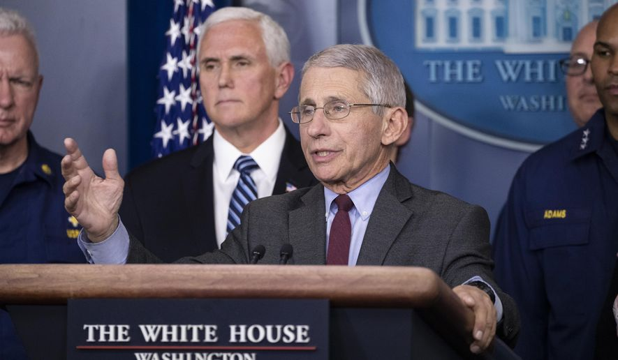 Dr. Anthony Fauci, director of the National Institute of Allergy and Infectious Diseases, with Vice President Mike Pence behind him, speaks during a briefing about the coronavirus in the James Brady Press Briefing Room of the White House, Sunday, March 15, 2020, in Washington. (AP Photo/Alex Brandon)
