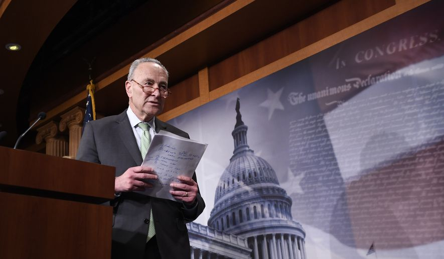 Senate Minority Leader Sen. Chuck Schumer of N.Y., walks off of the stage after speaking at a news conference on Capitol Hill in Washington, Tuesday, March 17, 2020. (AP Photo/Susan Walsh)