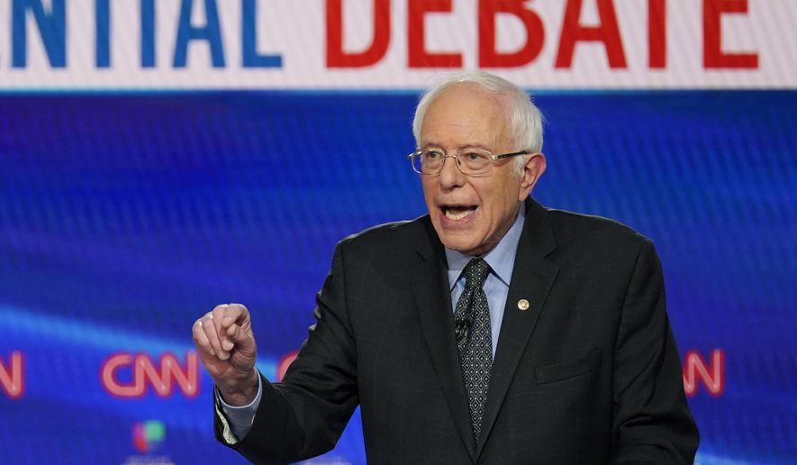 In this Sunday, March 15, 2020, photo, Sen. Bernie Sanders, I-Vt., with former Vice President Joe Biden, speaks during a Democratic presidential primary debate at CNN Studios in Washington. (AP Photo/Evan Vucci) ** FILE **