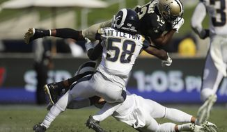 FILE - In this Sept. 15, 2019, file photo, New Orleans Saints wide receiver Michael Thomas, top, is tackled by Los Angeles Rams inside linebacker Cory Littleton during the second half of an NFL football game in Los Angeles. The Las Vegas Raiders have agreed with free agent linebacker Cory Littleton on a three-year contract. A person familiar with the contract says the sides came to agreement on the deal to give the Raiders a major upgrade at linebacker. The person spoke on condition of anonymity because the contract can't be signed until the start of the new league year on Wednesday, March 18, 2020.  (AP Photo/Marcio Jose Sanchez, File)