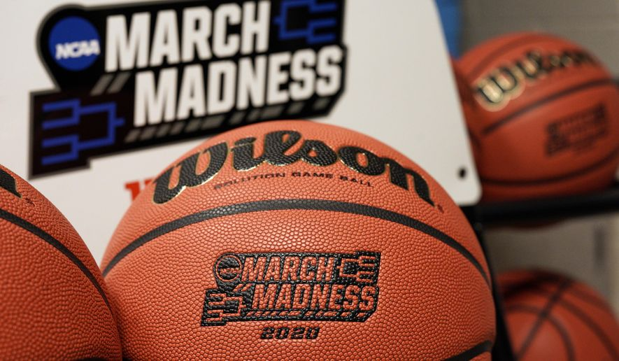 Official March Madness 2020 tournament basketballs are seen in a store room at the CHI Health Center Arena, in Omaha, Neb., Monday, March 16, 2020. Omaha was to host a first and second round in the NCAA college basketball Division I tournament, which was cancelled due to the coronavirus pandemic. (AP Photo/Nati Harnik)  **FILE**