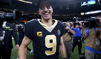 In this Dec. 16, 2019, file photo, New Orleans Saints quarterback Drew Brees (9) smiles after defeating the Indianapolis Colts 34-7 in an NFL football game in New Orleans. (AP Photo/Butch Dill) ** FILE **