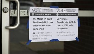 A sign is taped to a door leading into a polling location at the Messiah Lutheran Church, Tuesday, March 17, 2020, in Lyndhurst, Ohio. Ohio called off its presidential primary just hours before polls were set to open there and in three other states, an 11th-hour decision the governor said was necessary to prevent further fueling the coronavirus pandemic that has paralyzed the nation. (AP Photo/Tony Dejak)