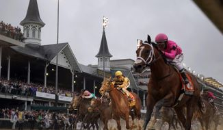 In this May 4, 2019, file photo, Luis Saez rides Maximum Security, right, across the finish line first against Flavien Prat on Country House during the 145th running of the Kentucky Derby horse race at Churchill Downs in Louisville, Ky. Citing unidentified sources close to the race, the Courier-Journal of Louisville said Churchill Downs will postpone the Derby from May 2, 2020, to Sept. 5, making it the first time in 75 years that the race won't be run on the first Saturday in May. (AP Photo/Matt Slocum, File)