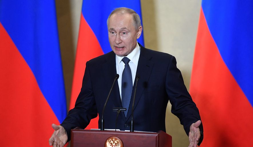 Russian President Vladimir Putin gestures while speaking during an awards ceremony for those who led the construction of the 19 kilometers (12 miles) road and rail Crimean Bridge which is intended to facilitate links with Crimea, which Russia annexed from Ukraine in 2014. in Sevastopol, Crimea, Wednesday, March 18, 2020. Putin traveled to Crimea on a trip marking the anniversary of its annexation from Ukraine in 2014. (Alexander Nemenov, Pool via AP)