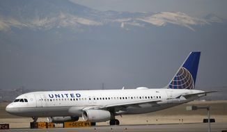 A United Airlines jetliner taxis down a runway for take off from Denver International Airport as airlines struggle with reduced passenger loads with the spread of coronavirus Wednesday, March 18, 2020, in Denver. According to the World Health Organization, most people recover in about two to six weeks depending on the severity of the illness. (AP Photo/David Zalubowski)