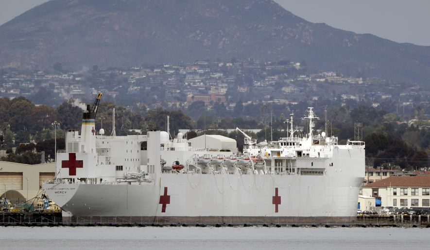 The USNS Mercy, a Navy hospital ship is seen docked at Naval Base San Diego Wednesday, March 18, 2020, in San Diego. Defense Secretary Mark Esper said Tuesday he has asked the Navy to prepare its two hospital ships  the USNS Mercy and the USNS Comfort in New York  for deployment to aid against the coronavirus outbreak. (AP Photo/Gregory Bull)