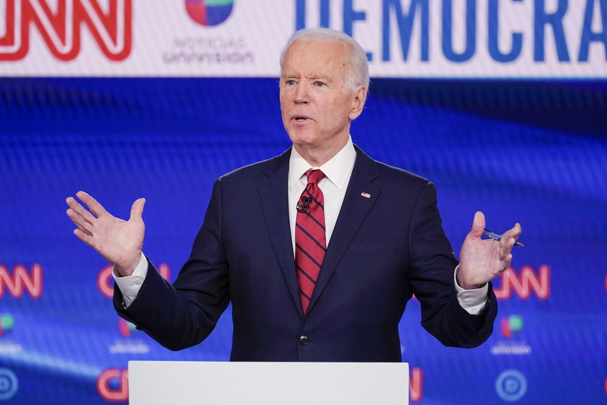 FILE- In this Sunday, March 15, 2020 file photo, former Vice President Joe Biden, participates in a Democratic presidential primary debate at CNN Studios in Washington. Joe Biden swept to victory in Florida, Illinois and Arizona on Tuesday, increasingly pulling away with a Democratic presidential primary upended by the coronavirus and building pressure on Bernie Sanders to abandon his campaign. (AP Photo/Evan Vucci, File)