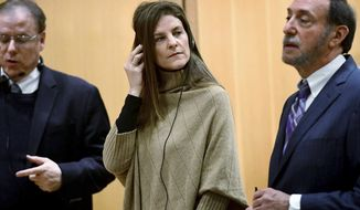 FILE - This Feb. 6, 2020 file photo shows Michelle Troconis appearance for a pre-trial hearing with an interpreter and her attorney Jon L. Schoenhorn, right, at the Stamford Superior Court in Stamford, Conn. Troconis, accused of helping to cover up the disappearance and presumed killing of a Connecticut mother of five, has asked a judge to block a variety of evidence, alleging police made false statements in several search warrant applications and didn't show there was probable cause for the searches. (Erik Trautmann/Hearst Connecticut Media via AP, Pool)