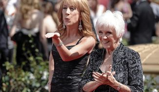 FILE - In this Aug. 29, 2010 file photo, Kathy Griffin and her mother Maggie Griffin arrive at the 62nd Primetime Emmy Awards in Los Angeles. Maggie Griffin, the mother of comedian Kathy Griffin, who inspired many of the jokes in her famous daughter's standup routines, died Tuesday, March 17, 2020. She was 99. (AP Photo/Chris Pizzello, File)