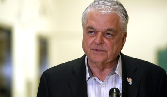 Nevada Gov. Steve Sisolak speaks during a news conference at the Sawyer State Building in Las Vegas,Tuesday, March 17, 2020. Sisolak ordered a monthlong closure of casinos and other non-essential businesses in order to stem the spread of the new coronavirus (COVID-19). (Steve Marcus/Las Vegas Sun via AP)
