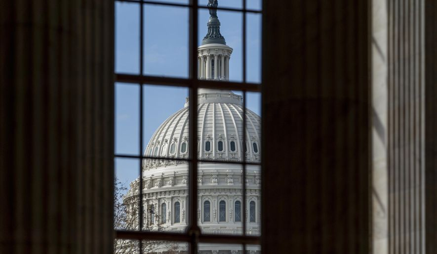 """A MoneyGeek survey's results underscored the deep economic shock the coronavirus and its concomitant business shutdowns have delivered. As of Friday, 22 states had issued """"shelter at home"""" rules, which have closed many businesses. (AP Photo/J. Scott Applewhite)"""
