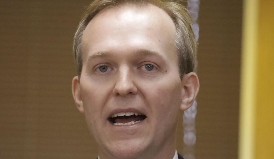 In this Dec. 16, 2019, photo Utah Rep. Ben McAdams speaks during a news conference in Murray, Utah. McAdams tested positive for the coronavirus on Wednesday, March 18, 2020, in an announcement that comes shortly after the first known case in Congress. (AP Photo/Rick Bowmer) **FILE**
