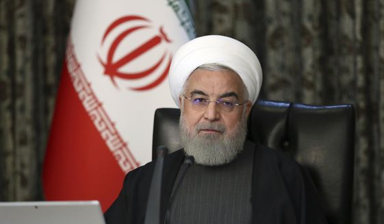 In this photo released by the official website of the Office of the Iranian Presidency, President Hassan Rouhani attends a Cabinet meeting in Tehran, Iran, Wednesday, March 18, 2020. (Office of the Iranian Presidency via AP) ** FILE **