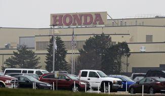 The Honda Marysville Auto Plant is shown, Wednesday, March 18, 2020, in Marysville, Ohio. Honda, which has 15,000 Ohio employees and is the state's largest manufacturer, said it will suspend all North American production beginning next week. (AP Photo/Tony Dejak)