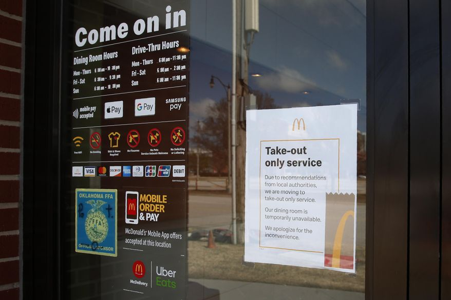 A sign announcing take-out service only is pictured at a McDonald's restaurant in Oklahoma City, Wednesday, March 18, 2020. Oklahoma City Mayor David Holt has declared a state of emergency due to the coronavirus outbreak and ordered that restaurants serve only take-out or delivery food through April 12, 2020. (AP Photo/Sue Ogrocki) ** FILE **