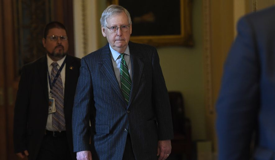 Senate Majority Leader Mitch McConnell of Ky., walks to his office on Capitol Hill in Washington, Thursday, March 19, 2020. (AP Photo/Susan Walsh)