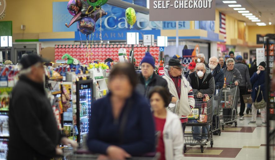 Shoppers wait in the checkout line at a Stop & Shop supermarket during hours open daily only for seniors Thursday, March 19, 2020, in North Providence, R.I. (AP Photo/David Goldman) ** FILE **