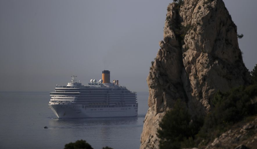 The trans-Atlantic cruise ship Costa Luminosa arrives in the port of Marseille, southern France, Thursday, March 19, 2020. The ship was allowed to stop in Tenerife in Spain on Sunday and offload three people who needed to be evacuated. For most people, the new coronavirus causes only mild or moderate symptoms. For some it can cause more severe illness. (AP Photo/Daniel Cole)