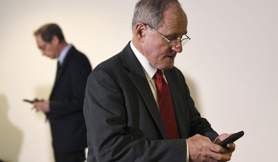In this file photo, Sen. Jim Risch, R-Idaho, who chairs the Senate Foreign Relations Committee, heads into a Republican policy lunch on Capitol Hill in Washington, Thursday, March 19, 2020. On May 21, Mr. Risch and fellow Republicans on his committee voted to recommend the Senate confirm Michael Pack to head up the U.S. Agency for Global Media. No Democrat on the panel voted in favor of the nomination. (AP Photo/Susan Walsh)