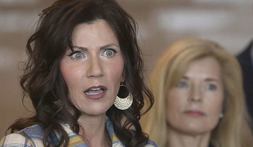 South Dakota Gov. Kristi Noem, left, updates media on the COVID-19 pandemic during a press conference Wednesday, March 18, 2020 at Monument Health in Rapid City, S.D. Noem said Wednesday testing for the COVID-19 virus was halted temporarily due to a lack of testing supplies at the South Dakota Department of Health laboratory in Pierre, S.D. (Jeff Easton/Rapid City Journal via AP)