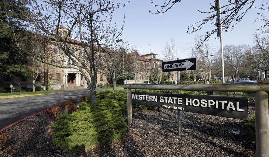 FILE - In this April 11, 2017, file photo, the entrance to Western State Hospital is seen in Lakewood, Wash. A patient as Washington state's largest psychiatric hospital has tested positive for coronavirus. Workers at Western State Hospital fear that number will increase due to a lack of protective gear. (AP Photo/Elaine Thompson, File)