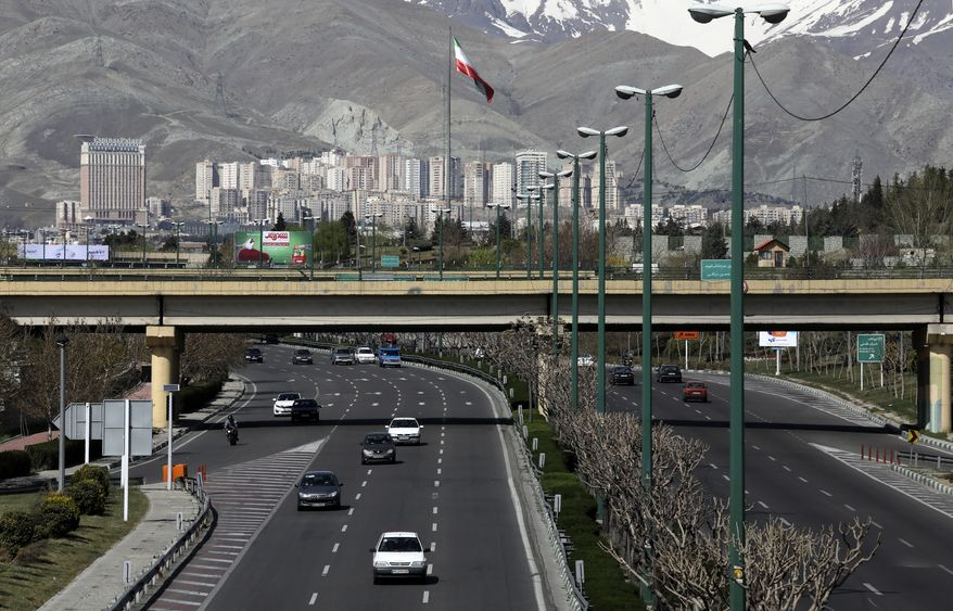 """Cars drive in a highway in northern Tehran, Iran, Friday, March 20, 2020, on the first day of Iranian New Year, called Nowruz, or """"New Day"""" in Farsi, the Persian holiday marking the the spring equinox. The new coronavirus has cut into the ancient Nowruz and has further slowed the Islamic Republic's economy. (AP Photo/Vahid Salemi)"""
