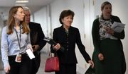 Sen. Susan Collins, R-Maine, arrives for a meeting on Capitol Hill in Washington, Friday, March 20, 2020, to work on an economic package to deal with the coronavirus. (AP Photo/Susan Walsh)
