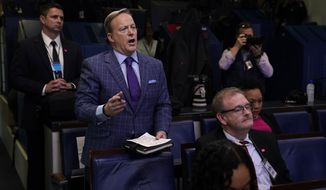 Former White House press secretary Sean Spicer and reporter for Newsmax, left, attends a coronavirus task force briefing at the White House, Friday, March 20, 2020, in Washington. (AP Photo/Evan Vucci)