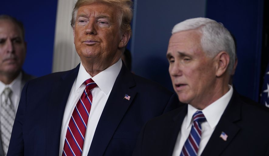 President Donald Trump listens as Vice President Mike Pence speaks during a coronavirus task force briefing at the White House, Friday, March 20, 2020, in Washington. (AP Photo/Evan Vucci)