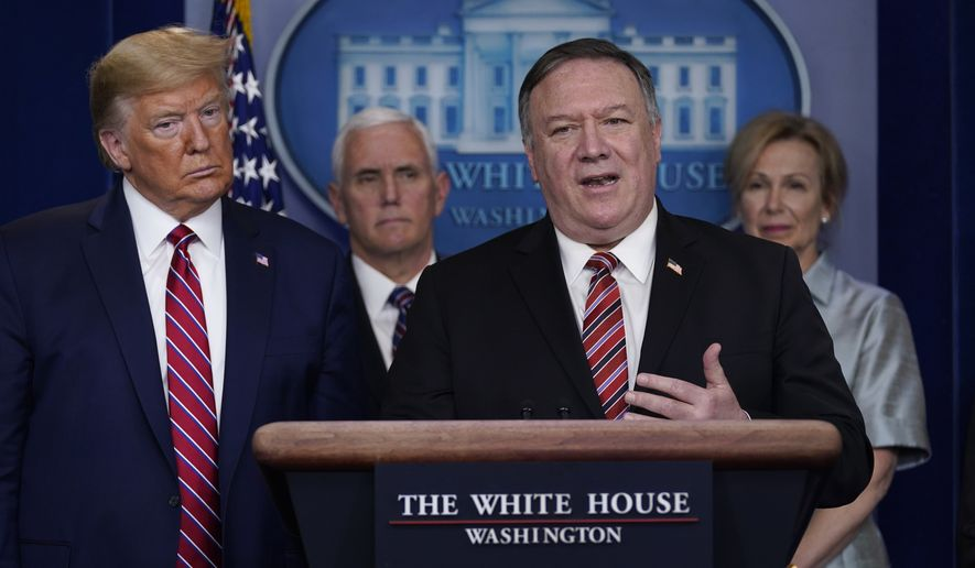 President Donald Trump listens as Secretary of State Mike Pompeo speaks during a coronavirus task force briefing at the White House, Friday, March 20, 2020, in Washington. From left, Trump, Vice President Mike Pence, Pompeo and White House coronavirus response coordinator Dr. Deborah Birx. (AP Photo/Evan Vucci)