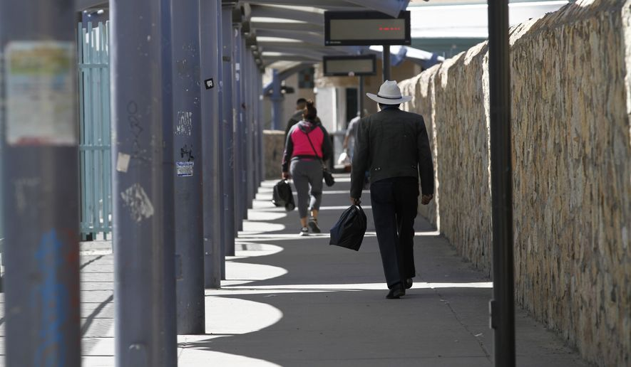 Travelers walk toward Ciudad Juarez, Mexico on Friday, March 20, 2020, a a border crossing in El Paso, Texas. Residents of both cities cross daily for family visits and to purchase basic good. Cigarettes and medications are cheaper on the Mexican side, electronics and alcohol are cheaper on the American side. President Donald Trump and Mexican Foreign Secretary Marcelo Ebrard said Friday the two governments will prohibit recreational and tourist travel starting at midnight, similar to the restrictions put in place earlier this week along the U.S. and Canadian border. (AP Photo/Cedar Attanasio)