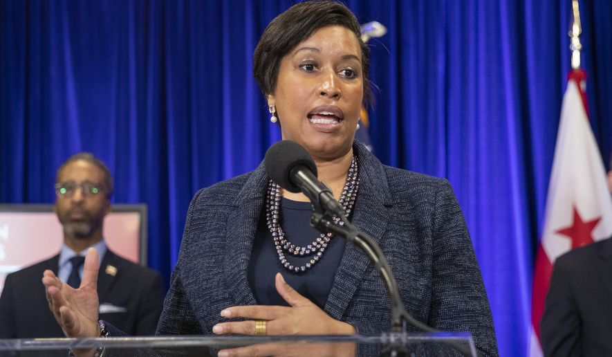 District of Columbia Mayor Muriel Bowser speaks about coronavirus during a news conference, Friday, March 20, 2020, in Washington. District of Columbia officials on Friday announced the first death of a patient from the COVID-19 illness in the nation's capital. (AP Photo/Manuel Balce Ceneta)