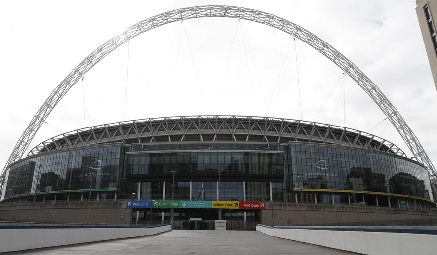 A general view of Wembley Stadium in London, Tuesday, March 17, 2020. UEFA has formally proposed postponing the 2020 European Championship for one year because of the coronavirus outbreak. The Norwegian soccer association says the new tournament dates will be June 11 to July 11. (AP Photo/Alastair Grant)